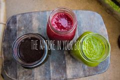 Vibrant Smoothies In Different Jars. The Nature In Your Bottle royalty free stock photos