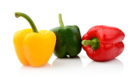 Three different coloured pepper isolated white. Three different coloured pepper isolated on white background royalty free stock photo