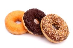 Three different donuts on white background royalty free stock photo