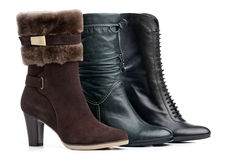 Three different female winter boots over white stock images