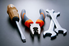 Three Different Hand Tools on a Gray Background Stock Image