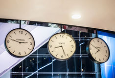 Three different international hanging wall clock, London, Tokyo, Stock Image