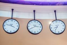 Three different international hanging wall clock, Tokyo, Paris, R Stock Photography
