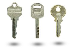 Three different keys on a white background. The concept of confidentiality or security of sensitive information stock photography
