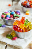 Three different kind of candy, gummy bears, chocolate drops, jel Stock Images