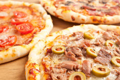 Three different kind of pizzas Stock Photography