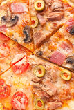 Three different kind of pizzas background Royalty Free Stock Photography