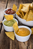 Three different nacho dips Royalty Free Stock Photography