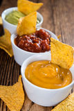 Three different nacho dips Royalty Free Stock Photos