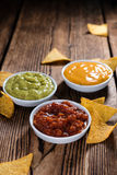 Three different nacho dips Stock Photo