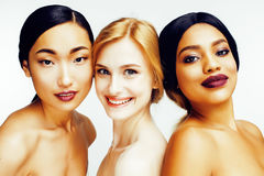 Three different nation woman: asian, african-american, caucasian together isolated on white background happy smiling Stock Image