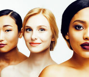 Three different nation woman: asian, african-american, caucasian together isolated on white background happy smiling Royalty Free Stock Images