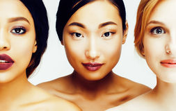 Three different nation woman: asian, african-american, caucasian together isolated on white background happy smiling Stock Photography