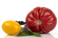 Three different organic tomatoes Stock Images