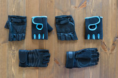 Three different pairs of gloves for fitness on the floor Stock Photo