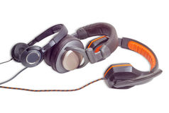 Three different pairs of headphones on a light background Royalty Free Stock Photography