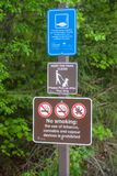 Park Signs - Rules for Visitors. Three different park signs inform all park visitors about the rules royalty free stock photos