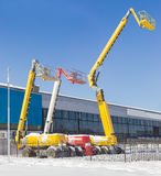 Three different self propelled wheeled boom lift with telescopin Stock Images