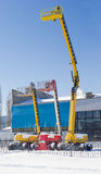 Three different self propelled wheeled boom lift with telescopin. Vertical panorama of the three different self propelled wheeled hydraulic articulated boom lift Stock Images