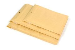Three different size bubble lined shipping or packing envelopes Stock Photos
