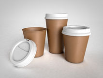 Three different size paper cups for coffee with plastic caps on Stock Photos