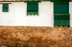 Three Different Sized Windows. Three windows of different sizes in a colonial town Royalty Free Stock Photo
