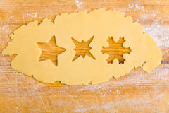 Three different stars on cookie. Three different stars shapes on raw cookie dough Stock Images