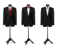 Three different suits on mannequins. Royalty Free Stock Images
