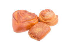 Three different sweet buns on a light background Stock Photos