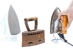 Three different times the iron with hand on a white background isolated, the beginning of the 20th century, the middle Royalty Free Stock Images