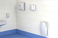 Three different types of hand dryers in the toilet. Automatic paper towel, hand dryer and jet hand dryer in the public toilet Royalty Free Stock Images