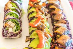Three different vegan sushi rolls ready to eat for a meal Stock Photos