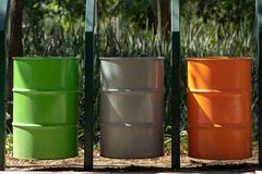 Three different waste bins in a public park royalty free stock photos
