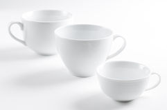 Three different white cups Stock Image