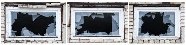 Three different windows with broken glasses. Stock Photo
