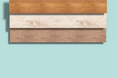 Three different wood planks on blue background Royalty Free Stock Image