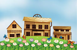 Three different wooden houses at the hill. Illustration of the three different wooden houses at the hill Stock Photo