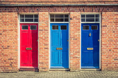 Three Differently Coloured Front Doors At The Entrance Of Old En Royalty Free Stock Photography