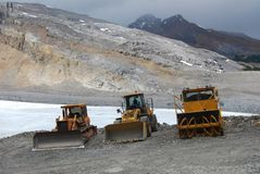 Three digger trucks on mountain Stock Photography