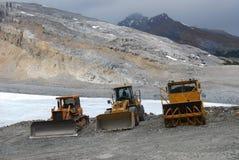 Three digger trucks on mountain Stock Photography