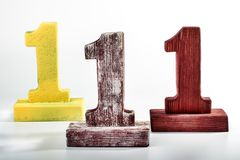 Three digits one of wood. Three digit one. the podium to be awarded Royalty Free Stock Photo
