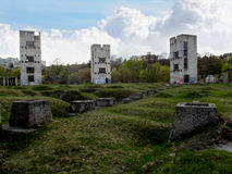 Three dilapidated sullen towers. Abandoned construction of three old tall buildings in the middle of the wasteland Stock Photo