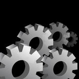 Three Dimensional Cog Wheel Background. An image of a cog wheels on a black background Royalty Free Stock Images
