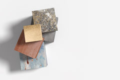 Three-dimensional cube made of different material Stock Photos