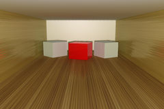 Three dimensional cubes on a wood floor Royalty Free Stock Image