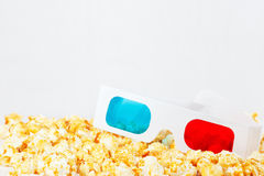 Three-dimensional glasses with popcorn Stock Images