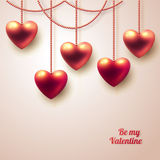 Three dimensional hanging hearts on light Stock Photo