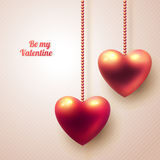 Three dimensional hanging hearts on light Stock Images