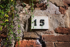 Three dimensional house number fifteen. Stock Photography