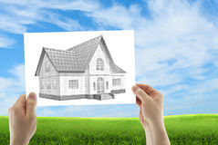 Three dimensional house sketch. Human hands holding three dimensional house sketch a of a future house Stock Images